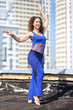 Woman in suit dancing Arabic dance