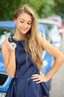 Beautiful young girl with long hair holding car key