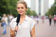 Reporter beautiful girl standing on the street