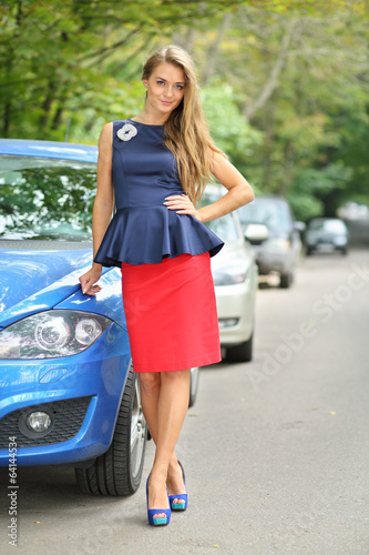Beautiful girl in a blue blouse and red skirt