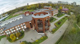 View from unmanned quadrocopter to brick building poster