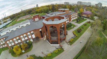 View from unmanned quadrocopter to brick building