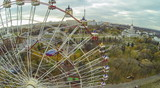 View from unmanned quadrocopter to ferris wheel poster