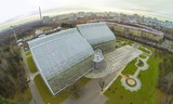 View from unmanned quadrocopter to futuristic glass building poster