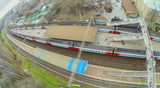 View from unmanned quadrocopter to train on railway platform poster