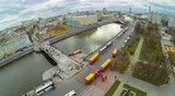 View from unmanned quadrocopter to buses near bridge poster