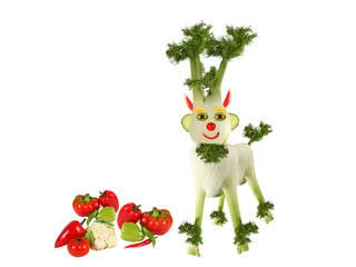 Goat made of fennel standing with vegetables