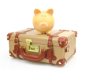 Closed brown suitcase with piggy bank on top of it