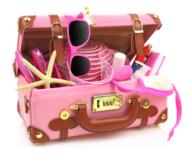 Ready to travel pink suitcase with summer equipment isolated