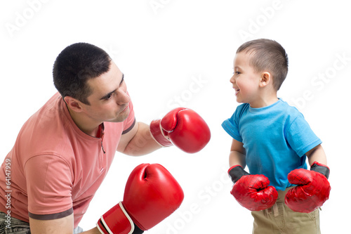 child and dad play with boxing gloves
