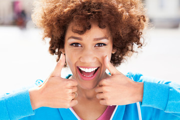 African American woman with thumbs up