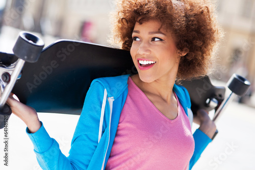 Young woman carrying longboard