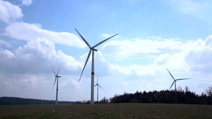 Wind turbine from an extreme angle with clouds moving overhead