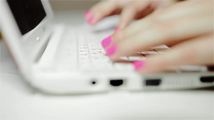 Women typing on white keyboard