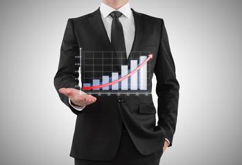 businessman shows graph