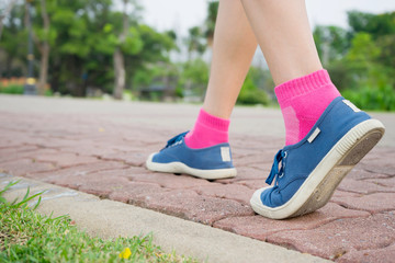 Woman walking in status section, exercising outdoors