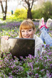Beautiful woman with a laptop on the nature