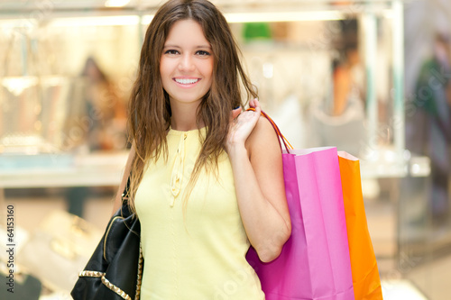Woman holding shopping bags in a shopping mall