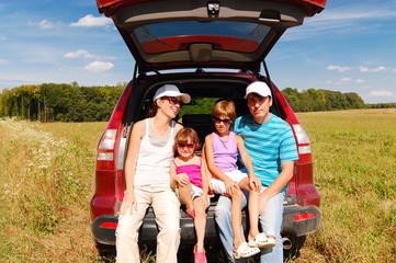 Family in car on vacation, parents and kids travel