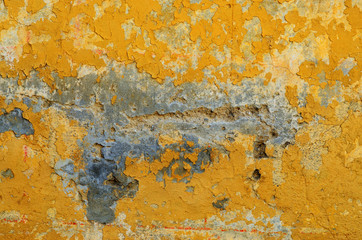 Texture of orange old shabby painted wall