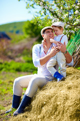 father and son on the farm, countryside