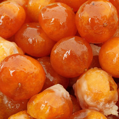 whole candied mandarin fruits as background