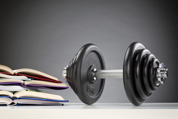 Dumbbell Next to Open Books