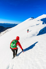 Mountaineers walking on the Kosuta ridge in Karavanke range