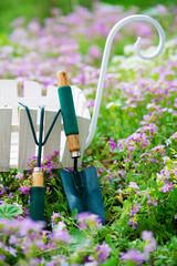 Gardening tools in spring garden