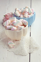 Pastel colored marshmallows in bowls, toned photo
