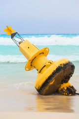 Yellow buoy on mexican beach
