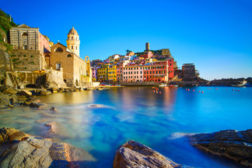 Vernazza village, curch, rocks and sea harbor on sunset. Cinque