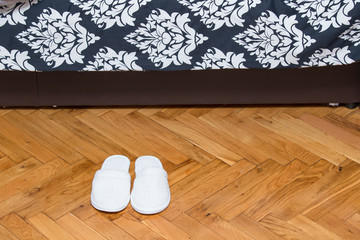 Slippers on wooden floor