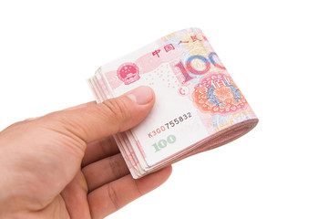 hand holding stack or RMB with clipping path