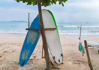 Two surf boards on sandy Weligama beach in Sri Lanka