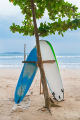 Two surf boards on sandy Weligama beach in Sri Lanka