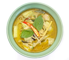 Thai cuisine green curry chicken on white background