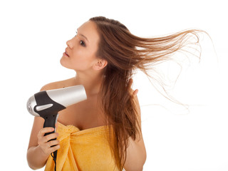beautiful young woman in towel with hairdryer