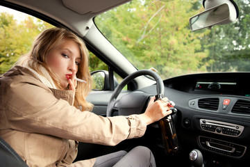 smoking woman  driving a car and drinking beer