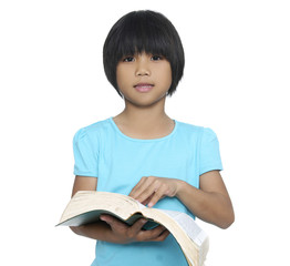Little girl with large book. Shot in studio over white.
