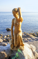 Sculpture of girl with jug on the coast of Black sea.