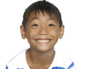 Portrait of young smile boy on yellow background
