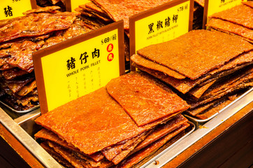 Assortment of Chinese preserved meat selling by the sidewalk of