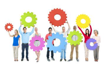 Business Teamwork Holding Cogs