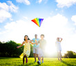 Family Playing Kite Outdoors
