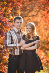 Portrait of a young couple in autumn Park