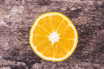 orange slices on wood background