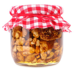 Walnuts and figs in honey homemade in jar