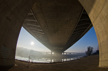 Sunrise on a river bank under cable bridge, Belgrade