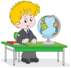 school student sitting at the desk with a globe